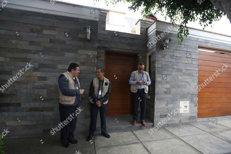 "Police stand guard outside of the home of former President Ollanta Humala and wife Nadine Heredia as it is searched in Lima, Peru, . Nadine Heredia is under investigation as part of the ""Lava Jato"" case, for allegedly receiving bribes from Odebrecht through the ""Gasoducto del Sur"" project, according to prosecutors"