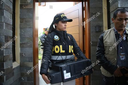 "A police officer carries a scanner out of the home of former President Ollanta Humala and wife Nadine Heredia during a search in Lima, Peru, . Nadine Heredia is under investigation as part of the ""Lava Jato"" case, for allegedly receiving bribes from Odebrecht through the ""Gasoducto del Sur"" project, according prosecutors"