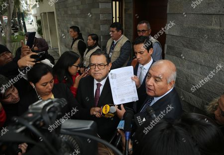 Stock Picture of Lawyers of former presidential couple Ollanta Humala and Nadine Heredia, Wilfredo Pedraza (R) and Alberto Otalora (L), speak with the media while members of the judicial police search the house of Heredia in Lima, Peru, on 09 July 2019.Peru's Prosecution searched the house of Heredia, wife of the Peruvian former president Ollanta Humala and other 26 buildings and offices in the framework of the investigation for alleged acts of corruption committed in the concession to Odebrecht of the works of the Gasoducto del Sur.