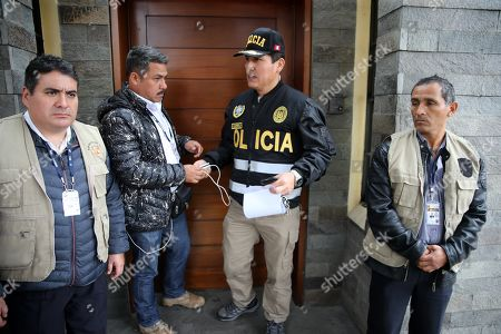 Stock Photo of Members of the judicial police search the house of former First Lady of Peru Nadine Heredia in Lima, Peru, on 09 July 2019. Peru's Prosecution searched the house of Heredia, wife of the Peruvian former president Ollanta Humala and other 26 buildings and offices in the framework of the investigation for alleged acts of corruption committed in the concession to Odebrecht of the works of the Gasoducto del Sur.