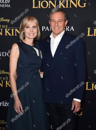 """Willow Bay, Robert Iger. Willow Bay, left, and Disney CEO Robert Iger arrive at the world premiere of """"The Lion King"""", at the Dolby Theatre in Los Angeles"""