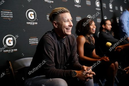 Stock Photo of Abby Wambach, Allyson Felix. Former U.S. Women's Soccer national team member Abby Wambach, left, and Olympic sprinter Allyson Felix conduct interviews during the High School Athlete of the Year Awards, in Los Angeles