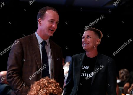 Abby Wambach, Peyton Manning. Former U.S. Women's Soccer national team member Abby Wambach and former NFL quaterback Peyton Manning chat during the High School Athlete of the Year Awards, in Los Angeles