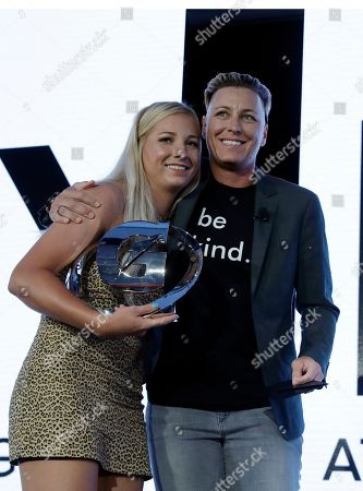 Kelley Lynch, left, a softball player for East Coweta High School in Sharpsburg, Ga., poses for photo with former U.S. Women's soccer national team member Abby Wambach after Lynch was named High School Athlete of the Year at an awards banquet, in Los Angeles