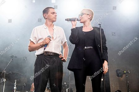 Peter Dreimanis, Leah Fay. Peter Dreimanis, left, and Leah Fay of July Talk perform during the Festival d'ete de Quebec, in Quebec City, Canada