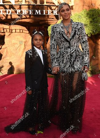 """Beyonce, Blue Ivy Carter. Beyonce, right, and her daughter Blue Ivy Carter arrive at the world premiere of """"The Lion King"""", at the Dolby Theatre in Los Angeles"""