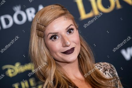 Anneliese van der Pol poses on the red carpet prior to the world premiere of 'The Lion King' at the Dolby Theater in Hollywood, California, USA, 09 July 2019. The film will be released in US theaters oExecutive producer Tom Peitzman posesn 19 July.