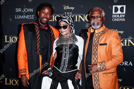 Atandwa Kani, his mother Mandi Kani and his father South African actor John Kani pose on the red carpet prior to the world premiere of 'The Lion King' at the Dolby Theater in Hollywood, California, USA, 09 July 2019. The film will be released in US theaters on 19 July.