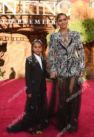 """Beyonce, Blue Ivy Carter. Beyonce, a cast member in """"The Lion King,"""" poses with her daughter Blue Ivy at the premiere of the film at the El Capitan Theatre, in Los Angeles"""