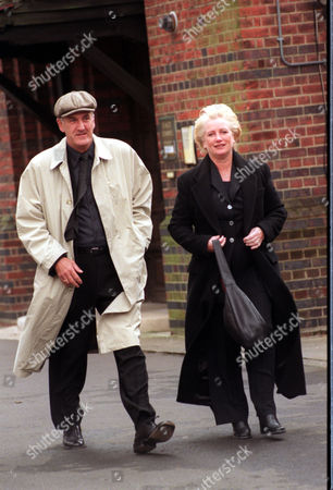 Stock Picture of Comedian And Sctor Russ Abbot Pictured With His Wife Trish Attend The Funeral Of Composer Lionel Bart.