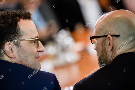 German Health Minister Jens Spahn (L) and State secretary at the Defense Ministry Peter Tauber talk during a cabinet meeting at the Chancellery in Berlin, Germany, 10 July 2019.