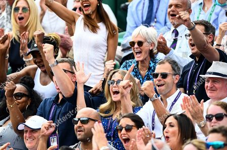 Venus Williams, Kim Sears, Judy Murray and the teams of Andy Murray and Serena Williams celebrate in the players box on Court 2