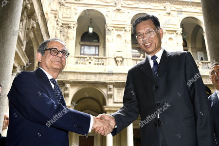 Italian Minister of Economy and Finance Giovanni Tria (L) shakes hands with China's Minister of Economy and Finance Liu Kun (R) during the Italy-China Financial Forum 2019, in Milan, Italy, 10 July 2019.