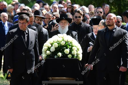 Stock Photo of The coffin is carried during the funeral of Artur Brauner (1918-2019) at the Jewish Cemetery Heerstrasse in Berlin, Germany, 10 July 2019. The German film producer and entrepreneur of Polish origin has died aged 100 on 07 July 2019.