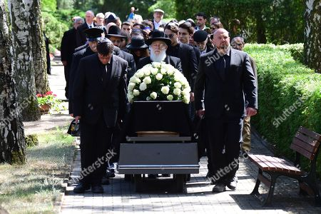 The coffin is carried during the funeral of Artur Brauner (1918-2019) at the Jewish Cemetery Heerstrasse in Berlin, Germany, 10 July 2019. The German film producer and entrepreneur of Polish origin has died aged 100 on 07 July 2019.