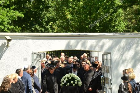 Stock Image of The coffin is carried during the funeral of Artur Brauner (1918-2019) at the Jewish Cemetery Heerstrasse in Berlin, Germany, 10 July 2019. The German film producer and entrepreneur of Polish origin has died aged 100 on 07 July 2019.