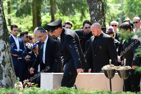 Stock Picture of The coffin is carried during the funeral of Artur Brauner (1918-2019) at the Jewish Cemetery Heerstrasse in Berlin, Germany, 10 July 2019. The German film producer and entrepreneur of Polish origin has died aged 100 on 07 July 2019.