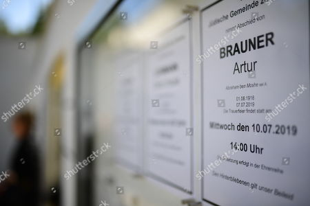 An announcement for the funeral of Artur Brauner (1918-2019) hangs in a display at the Jewish Cemetery Heerstrasse in Berlin, Germany, 10 July 2019. The German film producer and entrepreneur of Polish origin has died aged 100 on 07 July 2019.