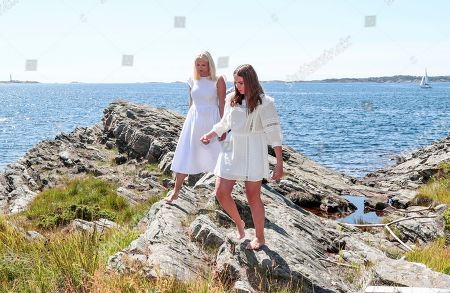 Norway's Crown Princess Mette-Marit (L) and Princess Ingrid Alexandra pose near the country house on Dvergsoya island, outside Kristiansand, Norway, 10 July 2019. The Norwegian royals are spending their annual summer vacation on Dvergsoya.