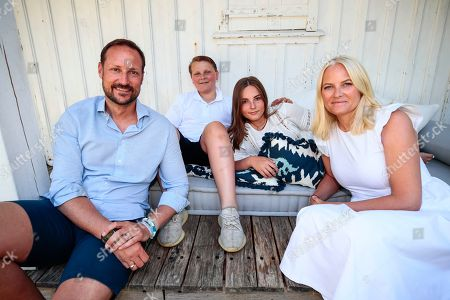 (L-R) Norway's Crown Prince Haakon, Prince Sverre Magnus, Princess Ingrid Alexandra and Crown Princess Mette-Marit pose at the country house on Dvergsoya island, outside Kristiansand, Norway, 10 July 2019. The Norwegian royals are spending their annual summer vacation on Dvergsoya.