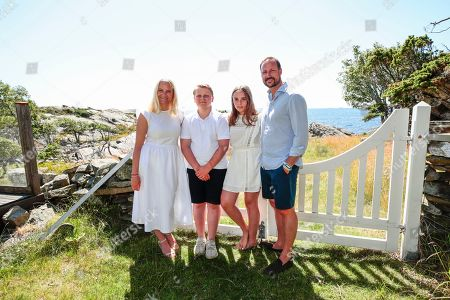 (R-L) Norway's Crown Prince Haakon, Princess Ingrid Alexandra, Prince Sverre Magnus and Crown Princess Mette-Marit pose at the country house on Dvergsoya island, outside Kristiansand, Norway, 10 July 2019. The Norwegian royals are spending their annual summer vacation on Dvergsoya.