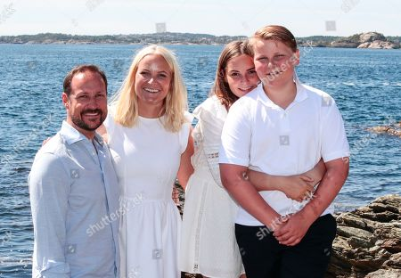 (L-R) Norway's Crown Prince Haakon, Crown Princess Mette-Marit, Princess Ingrid Alexandra and Prince Sverre Magnus pose near the country house on Dvergsoya island, outside Kristiansand, Norway, 10 July 2019. The Norwegian royals are spending their annual summer vacation on Dvergsoya.