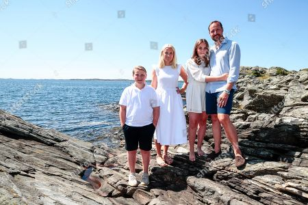 (R-L) Norway's Crown Prince Haakon, Princess Ingrid Alexandra, Crown Princess Mette-Marit and Prince Sverre Magnus pose near the country house on Dvergsoya island, outside Kristiansand, Norway, 10 July 2019. The Norwegian royals are spending their annual summer vacation on Dvergsoya.