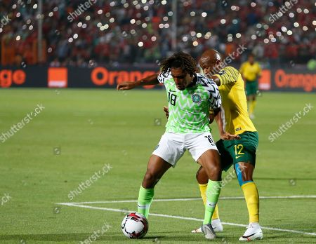 Stock Photo of South Africa's Sandile Hlanti, lelft, and Nigeria's Abdullahi Shehu fight for the ball during the African Cup of Nations s quarterfinal soccer match between Nigeria and South Africa in Cairo International Stadium, Egypt