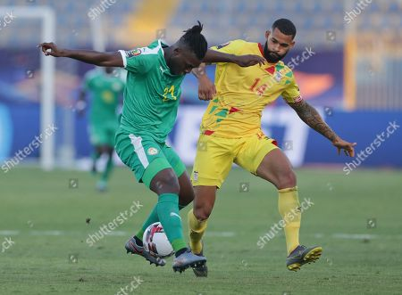 Senegal's Lamine Gassama, left, and Benin's Cebio Soukou fight for the ball during the African Cup of Nations quarterfinal soccer match between Senegal and Benin in 30 June stadium in Cairo, Egypt