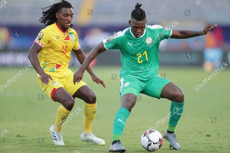 Stock Image of Benin's Sessi D'almeida, left, and Senegal's Lamine Gassama fight for the ball during the African Cup of Nations quarterfinal soccer match between Senegal and Benin in 30 June stadium in Cairo, Egypt