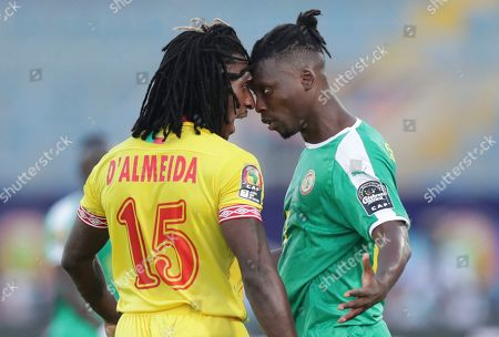Benin's Sessi D'almeida, left, and Senegal's Lamine Gassama argue during the African Cup of Nations quarterfinal soccer match between Senegal and Benin in 30 June stadium in Cairo, Egypt