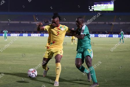 Benin's David Djigla, left, and Senegal's Youssouf Sabaly fight for the ball during the African Cup of Nations quarterfinal soccer match between Senegal and Benin in 30 June stadium in Cairo, Egypt