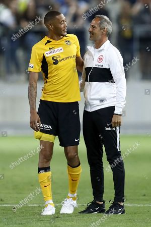 Frankfurt's head coach Adi Huetter, right, talks to YB's Guillaume Hoarau after a friendly soccer match of the international Uhrencup tournament between Switzerland's BSC Young Boys and Germany's Eintracht Frankfurt at the Tissot Arena in Biel, Switzerland, Wednesday, July 10, 2019.