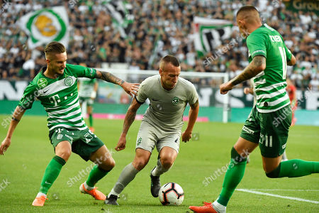 Jacek Goralski (C) of Ludogorec, Michal Tokmac (L) and Oleksandr Zubkov of Ferencvaros in action during the UEFA Champions League first qualifying round first leg match Ferencvaros vs Ludogorec in Groupama Arena in Budapest, Hungary, 10 July 2019.
