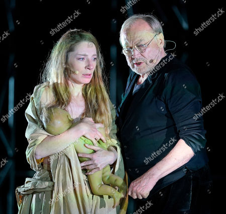 Klaus Maria Brandauer (R) as Hagen and Kathleen Morgeneyer as Kriemhild perform on stage during a photo rehearsal of 'Ueberwaeltigung' (lit. overpowering) for the Nibelungen Festival Worms, in Worms, Germany, 10 July 2019.The festival features the old Norse and Germanic mythology saga of the 'Nibelungen' about the life and love, treason and tragedy of the Burgundians royal family and their legendary treasure in Worms in the fifth century. This year's the festival is titled 'Ueberwaeltigung' (lit. overpowering) and will be held on an open-air stage in front of Worms Cathedral from 12 to 28 July 2019.