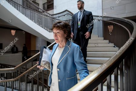 Sen. Susan Collins, R-Maine, arrives for a closed door meeting for Senators on election security on Capitol Hill in Washington