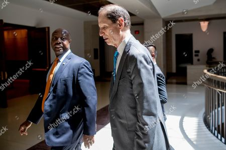 Ron Wyden, Tim Scott. Sen. Tim Scott, R-S.C., left, and Sen. Ron Wyden, D-Ore., right, arrive for a closed door meeting for Senators on election security on Capitol Hill in Washington