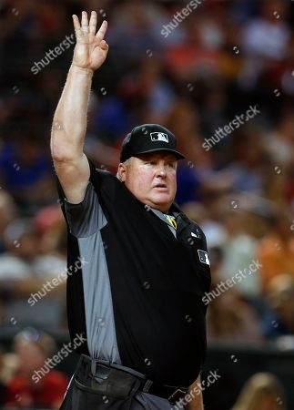 MLB umpire Bill Miller (26) in the first inning during a baseball between the Colorado Rockies the Arizona Diamondbacks, in Phoenix