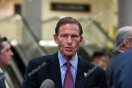 Sen. Richard Blumenthal, D-Conn., talks with reporters on Capitol Hill in Washington, before attending a briefing on election security