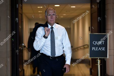Sen. Thom Tillis, R-N.C., walks on Capitol Hill in Washington, as he heads to a briefing on election security