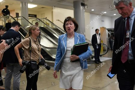 Sen. Susan Collins, R-Maine, walks past reporters on Capitol Hill in Washington, as she heads to a briefing on election security