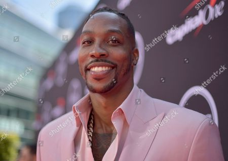 NBA player Dwight Howard, of the Memphis Grizzlies, arrives at the ESPY Awards, at the Microsoft Theater in Los Angeles