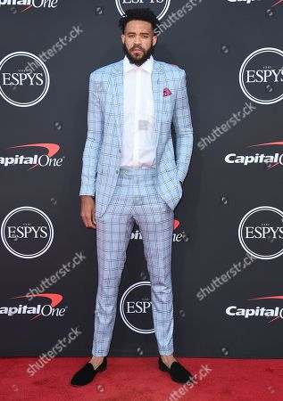 NBA player JaVale McGee, of the Los Angeles Lakers, arrives at the ESPY Awards, at the Microsoft Theater in Los Angeles