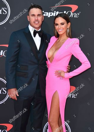 Brooks Koepka, Jena Sims. Professional golfer Brooks Koepka, left, and Jena Sims arrive at the ESPY Awards, at the Microsoft Theater in Los Angeles