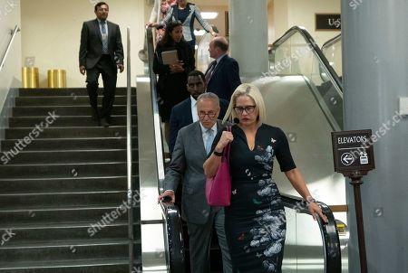 United States Senate Minority Leader Chuck Schumer (Democrat of New York) and United States Senator Kyrsten Sinema (Democrat of Arizona) arrive to a closed door briefing on American election security