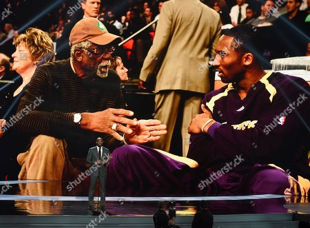 Kobe Bryant present the Arthur Ashe award for courage at the ESPY Awards, at the Microsoft Theater in Los Angeles. Pictured on screen are Bryant, right, and honoree Bill Russell