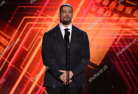 Roman Reigns presents the best coach award at the ESPY Awards, at the Microsoft Theater in Los Angeles