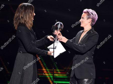 Sandra Bullock, Megan Rapinoe. Sandra Bullock, left, presents the award for best team to Megan Rapino of the U.S. women's national soccer team at the ESPY Awards, at the Microsoft Theater