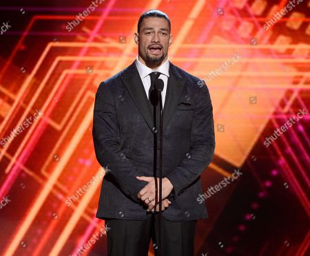 Stock Image of Roman Reigns presents the best coach award at the ESPY Awards, at the Microsoft Theater in Los Angeles