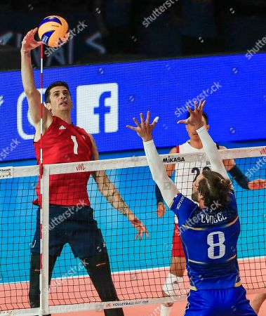 USA's Matthew Anderson (L) in action against France's Julien Lyneel (R) during the Federation Internationale de Volleyball (FIVB) Men's Nations League match between France and USA at Credit Union 1 Arena in Chicago, Illinois, USA, 10 July 2019.